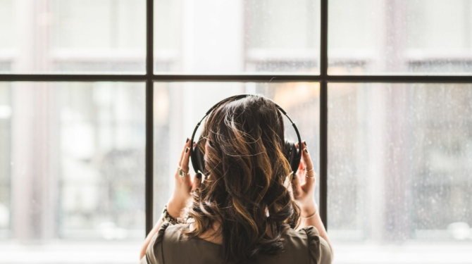 woman listening to investment podcast