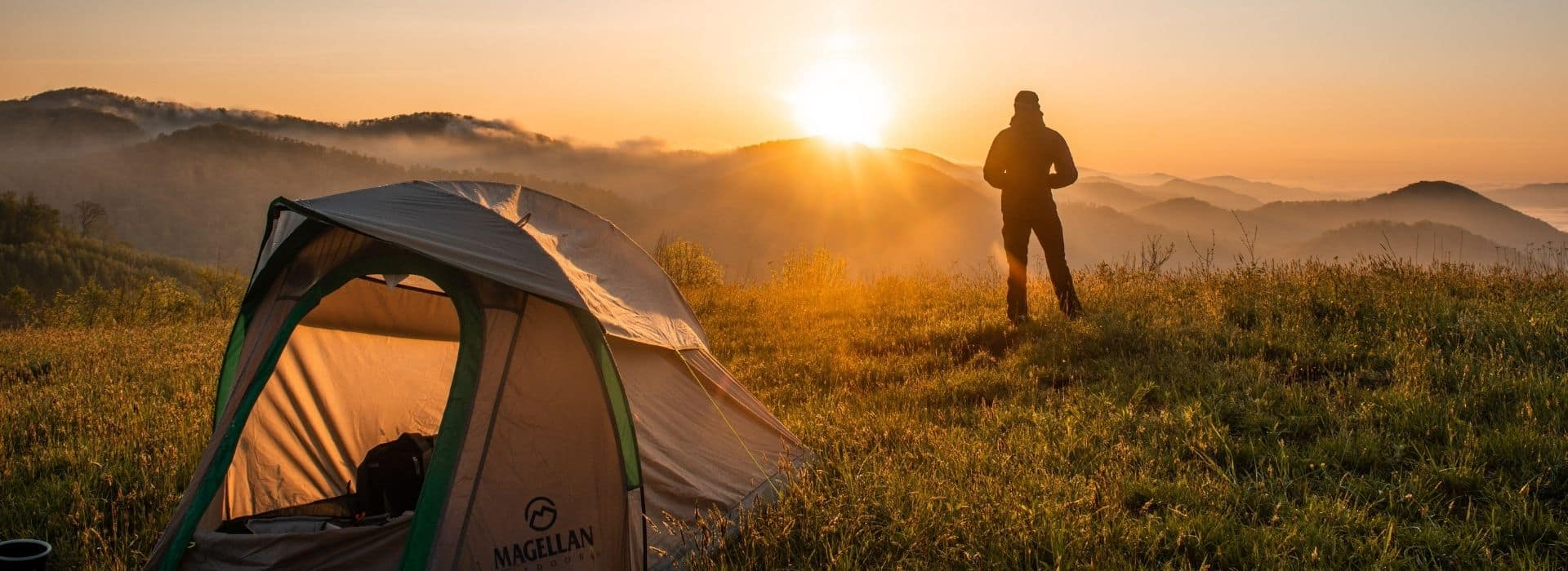 man camping at sunrise in Cyprus